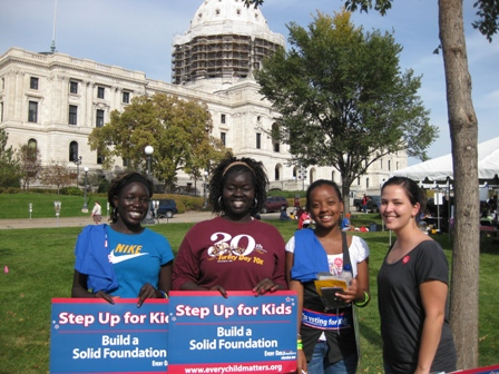 Promise Fellows holding Step Up for Kids