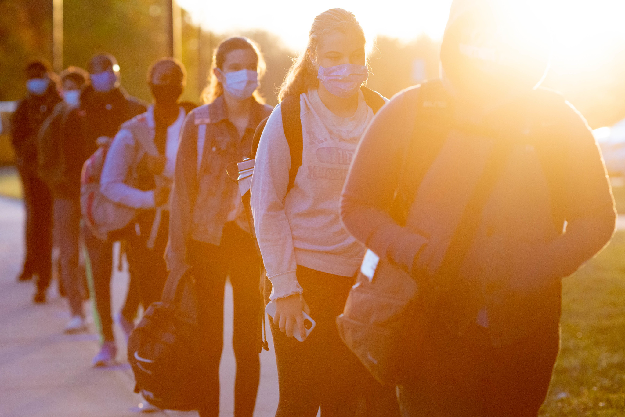 Students in a line with masks on