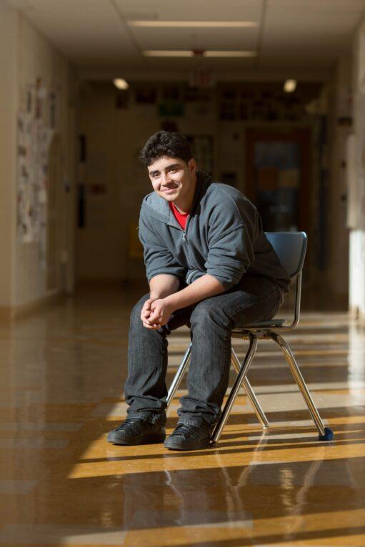 Student sitting in hallway