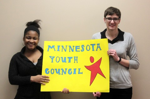 Students holding MYC sign
