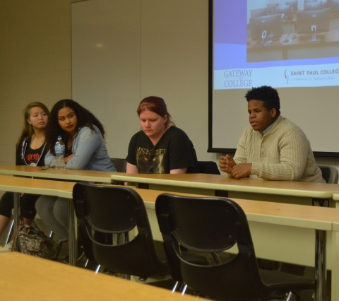 students sitting on a panel